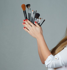 Professional make-up brush cosmetic in female hand beautician