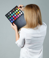 beautiful woman with make up brushes and palette