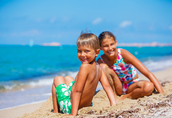 Boy with his sister on the beach