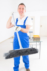 Smiling cleaner at the office