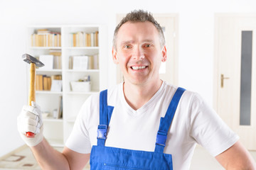 Man with hammer at home or office