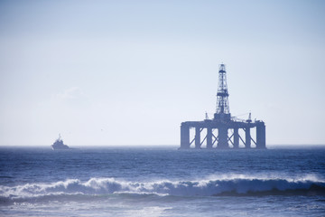 Oil rig in the distance at sea