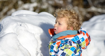 little 3 year old child  in the snow