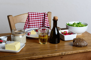 plate with radish and butter on a rustic table