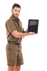 Man in khaki uniform presenting a digital tablet.