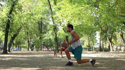 Young adult doing exercises in the park, extreme workout