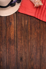 wooden background with sunglasses, hat vacation concept