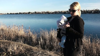 Mom and Baby in Carrier by Lake