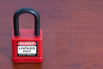 Lockout Padlock red color on wood background