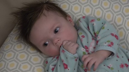 Baby Trying to Suck Thumb