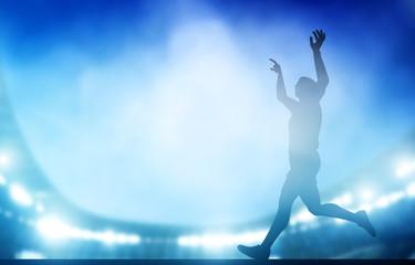Finish of the run on the stadium in night lights. Athletics, win