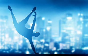 Hip hop, break dance performed by young man in city lights