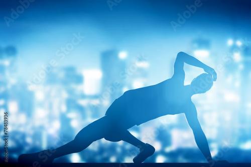 Tuinposter Gymnastiek Hip hop, break dance performed by young man in city lights