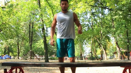 Fitness man,athlete working exercises in the park