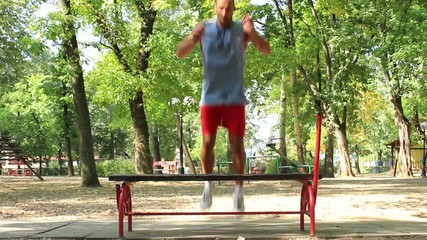 Man exercising in the park,legs exercises,wide angle