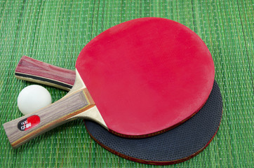 Two table tennis rackets on green surface