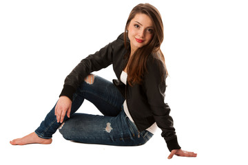attractive young woman sitting isolated over white background