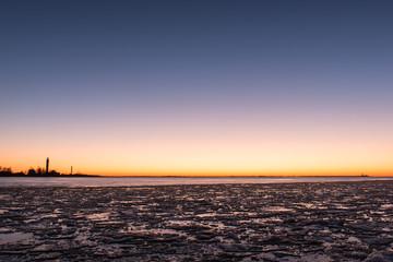sunset over frozen sea