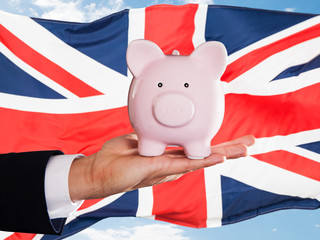 British Businessman Holding Piggybank