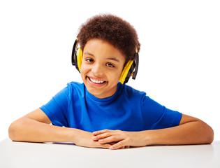 Cheerful African American school boy with headset