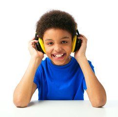 African American school boy listening music with headset