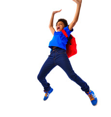 Excited African American school boy jumping