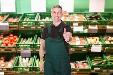 Male Sales Clerk Showing Thumb Up Gesture