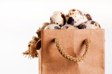 Brown pack with quail eggs