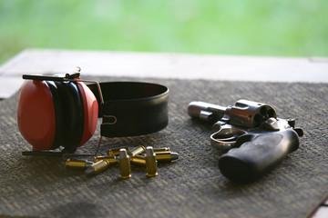 handgun ammunition and earmuff