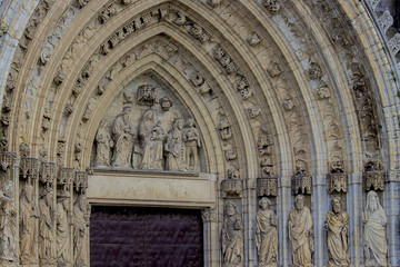 detail carving up of the red door of church in north of spain