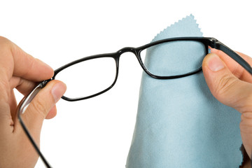 Person Cleaning Eyeglasses
