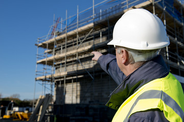 Civil Engineer Pointing At Building Site