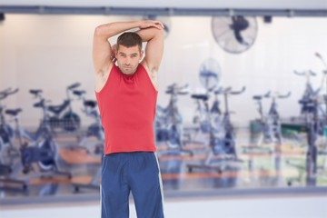 Composite image of fit man stretching his arms