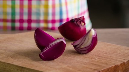 Slow motion: Chopped Red Onion On Wooden Board