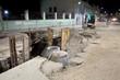 Leinwanddruck Bild - Hydro construction work, reconstruction of sewerage, night photo