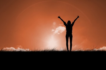 Composite image of silhouette of cheering woman