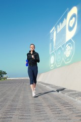 Composite image of fit blonde jogging on the pier