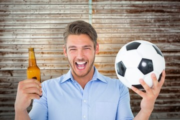 Composite image of handsome young man holding ball and beer