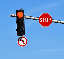 Red traffic light and stop sign