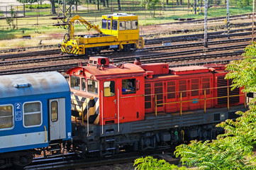 Red diesel engine and a yellow maintenance railway car