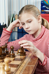 Girl playing in chess game