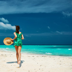 Woman in green dress at beach