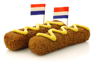 """Two Dutch snacks called """"kroket"""" with mustard and  Dutch flag"""