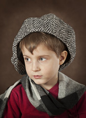 Portrait of a little boy in a hat