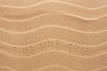 Time inscription on the wavy sand