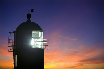 Scenic view of lighthouse and at sunset