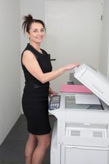secretary using a copy machine