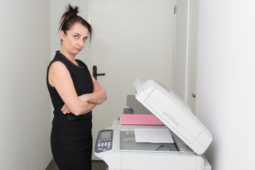 secretary using a copy machine