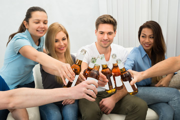 Group Of Friends Toasting Beer Bottles