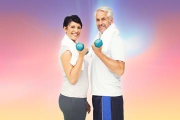 Portrait of a fit mature couple exercising
